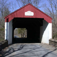 This bridge spans Cabin Run Creek, named for the many small houses along its banks in the 1800s. It is on Covered Bridge Road in Plumstead Township, downstream from Loux Covered Bridge and near the historic Stover-Myers Mill.<br> Built: 1871<br> Height Limit: 11 ft 10 in<br> Width Limit: 15 ft<br> Length: 82 feet<br> Weight Limit: 3 tons <a href=http://buckscountyalive.com/maps/CallGoogleMap.cfm?map=bcalive-attractions target=_blank>Map</a>