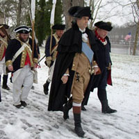 Washington Crossing Historic Park was founded in 1917 to perpetuate and preserve the site from which the Continental Army crossed the Delaware River. This purpose is achieved by interpreting the historical significance of this site for thousands of Park visitors each year through tours, exhibits and various special events. The spirit of the 1776 Crossing is recreated every year on Christmas Day when the annual reenactment of Washington Crossing the Delaware takes place on December 25. In this annual reenactment the visitor can see reenactors in Continental military dress cross the river in the replica Durham boats.