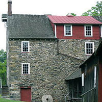 Stover-Myers Mill, which comprises 26 acres along the Tohickon Creek in Bedmnster Township on Dark Hollow Road and the creek in Pipersville. Originally, this mill started as a water-powered gristmill/sawmill and was later powered by steam. Owned by Jacob Stover in the early 1800's, the Stover-Myers Mill produced flour and animal feed for regional and local consumption.