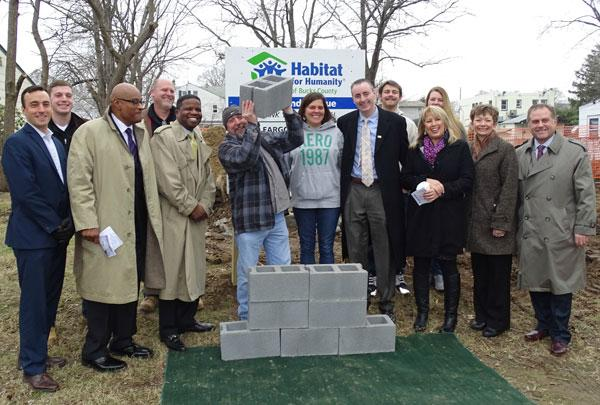 Photo caption: Attending Habitat for Humanity of Bucks County's wall raising in Morrisville were (l to r) Christopher Smylie (Parx Casino), Kevin Long (Toll Brothers), Ron Davis (Parx Casino), Ken Hill (Toll Brothers), Stephen Briggs (Wells Fargo), Bill and Tina (homebuyers), Congressman Brian Fitzpatrick, Jarrett and Alyson (family members), Michelle Saldutti (Parx Casino), Florence Kawoczka (Habitat Bucks County), and Todd Hurley (Penn Community Bank).Photo credit: Stefanie Clark