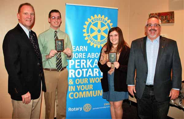 Neil Fosbenner, left, and Bob Hipp, right, present Student of the Month recognition from Perkasie Rotary to Pennridge High School students Chad Schaeffer and Kaitlyn Stevens.